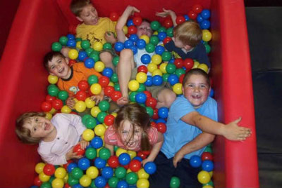 Ball pit with kids in it
