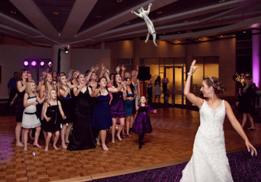 Bride tosses a doll into crowd