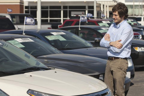 Man buying car at used car dealer