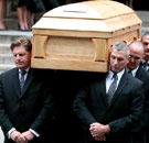 Carrying funeral casket