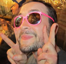 Casey Freeman wearing sunglasses giving the peace sign