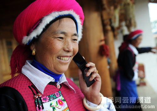 Chinese middle class woman with a flip cell phone