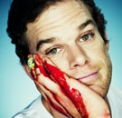 Dexter Morgan smiling with blood on his face