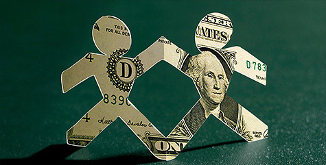 People figures cut out of dollar bills