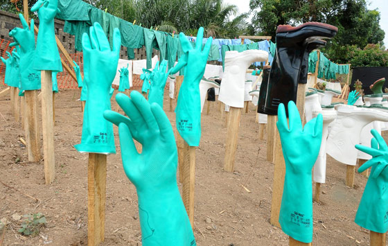 Ebola crisis decontaminating gloves and doctor outfits