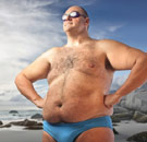Proud fat guy in a Speedo at the beach