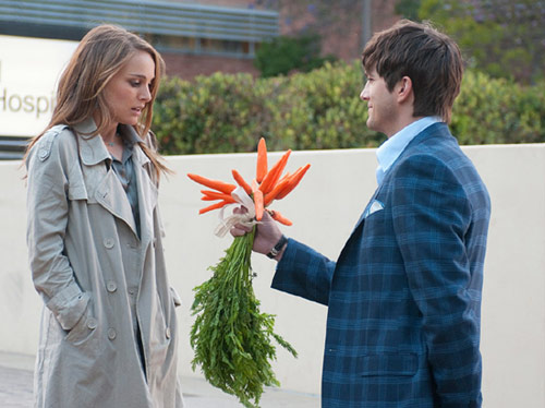 Guy gives girl carrots as flowers