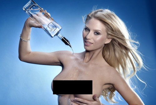 G Spirits blonde model pouring liquor on her breasts