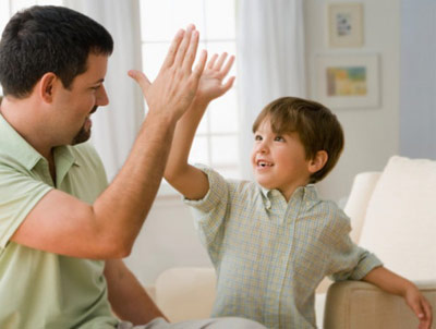 Kid high fiving an adult