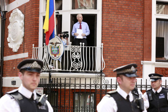 Julian Asange stands on balcony of Ecuador embassy in London England