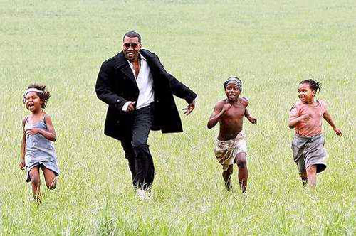 Kanye with African children