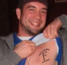 KC sports an F chest tattoo for Freeman