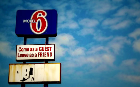 "Motel 6 ""come as a guest, leave as a friend"" sign"