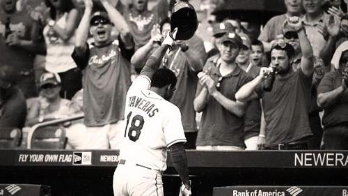 Oscar Taveras tips his hat to fans at the stadium after a homerun