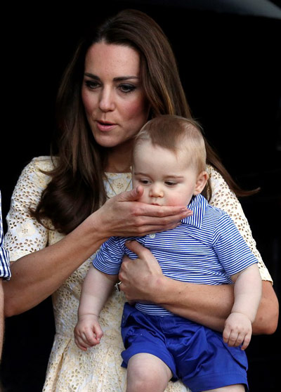 Kate Middleton holding Prince George