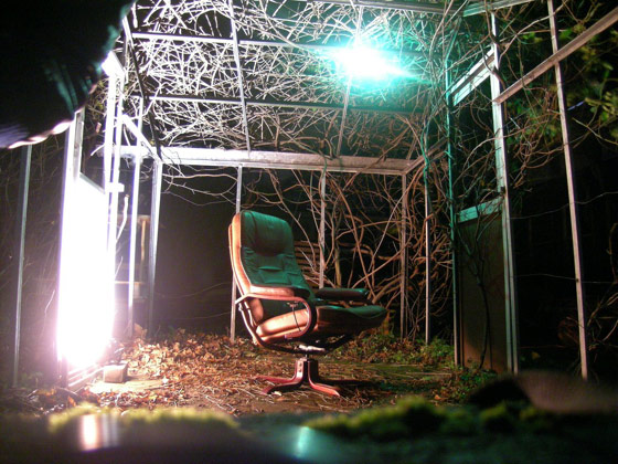Single black chair at a psych ward at night
