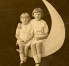 Two racist children sitting on the moon