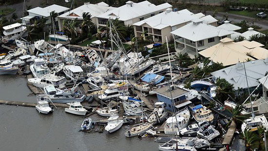Rich people's yachts all crashed at a dock
