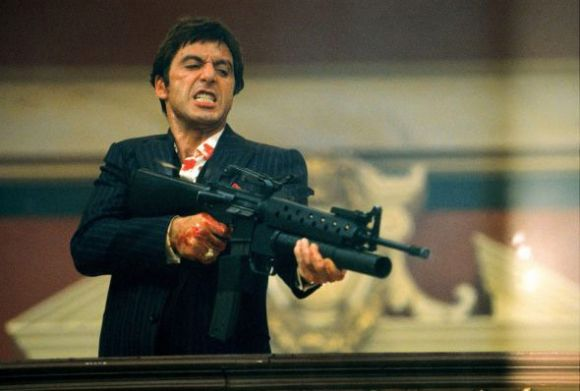 Tony Montana in Scarface with an AK-47 machine gun