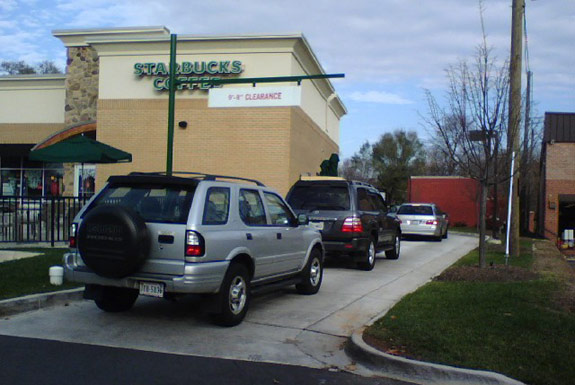 Cars lined up in a Starbucks drive-thru