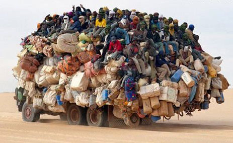 Overcrowded truck in the desert