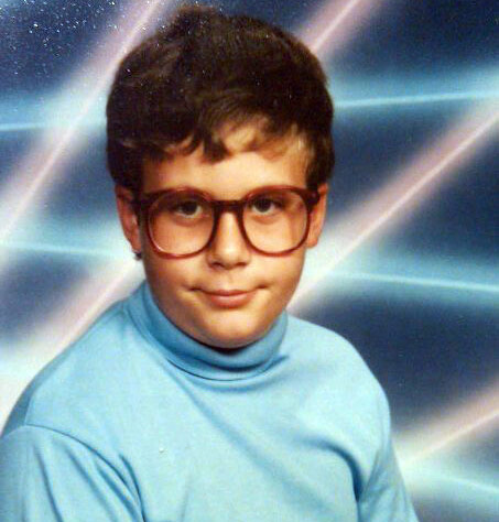 Middle school yearbook photo of nerdy boy