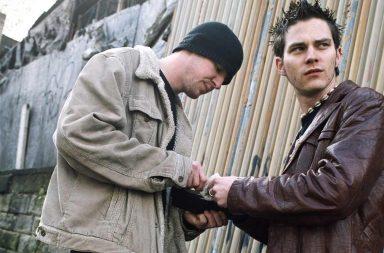 Drug dealers making a drug deal on the street