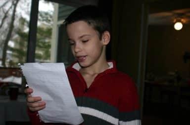 Boy reading suicide letter