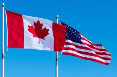 Canadian flag in front of American flag