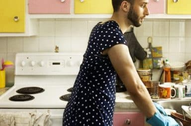 Man in an apron in the kitchen