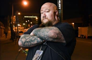Tattooed bouncer outside a bar