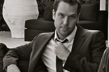 Dane Cook wearing a suit