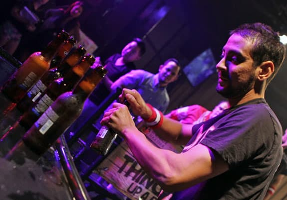 Barback serving drinks at a bar