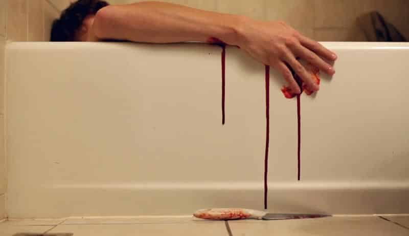 Man slit his wrists to commit suicide in a bathtub
