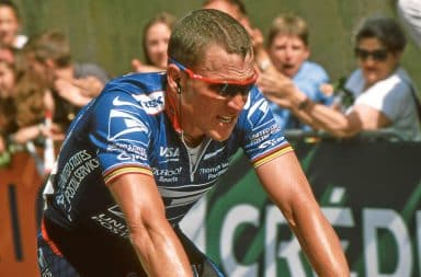 Lance Armstrong riding a bicycle