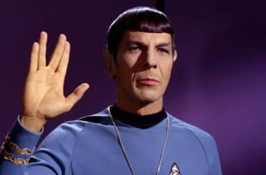 Leonard Nimoy as Spock giving the hand sign