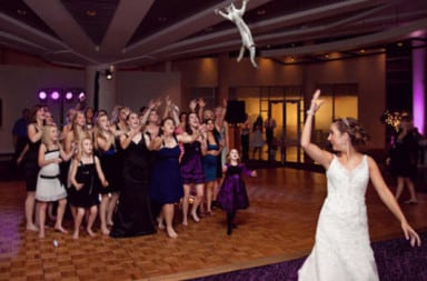 Bride tosses doll bouquet