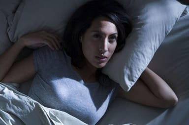 Woman can't fall asleep in bed