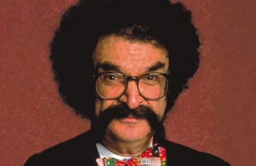 Gene Shalit with big hair and mustache