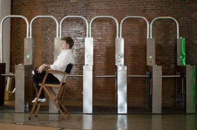 Director of musical in subway set with turnstiles