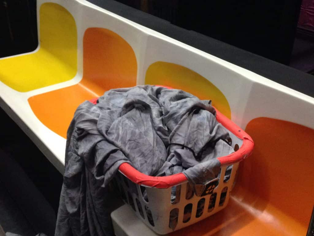 Laundry basket on empty subway train