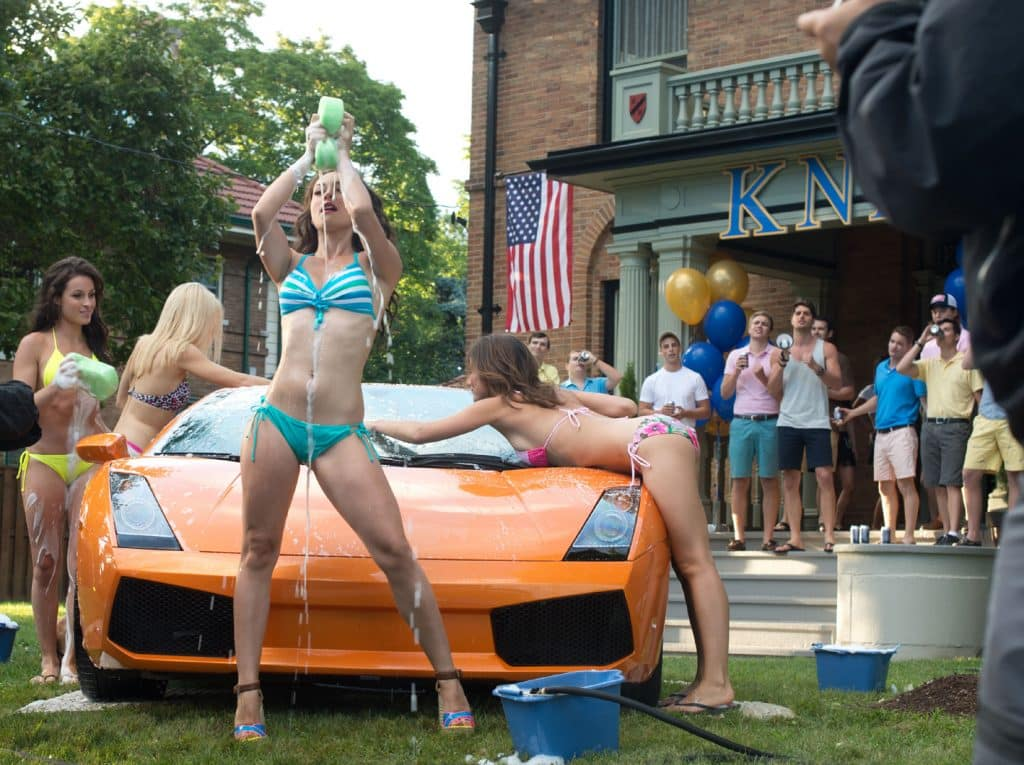 Babes washing a car in front of a fraternity