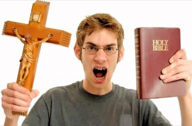 Man angry at God, holding a cross and a Bible