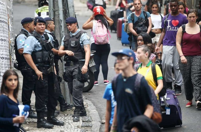 Nervous American tourists in Brazil near police with rifles