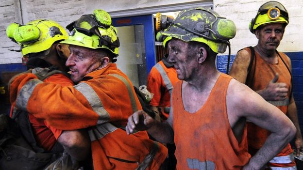 Coal miners hugging