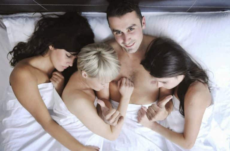 Husband with three wives in bed