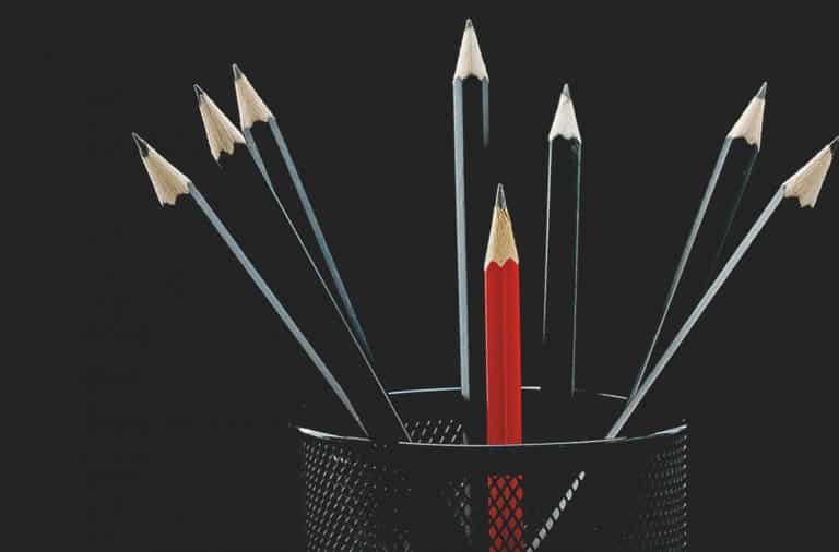Red pencil within black pencils