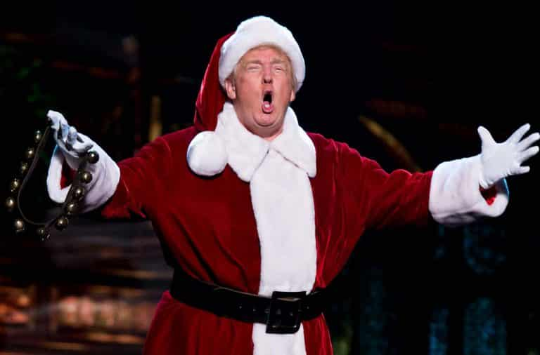 Donald Trump in a Santa outfit on stage