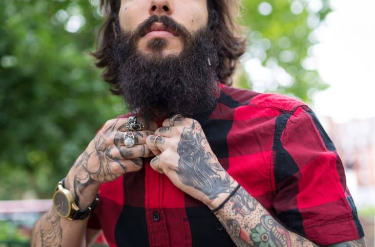 Hipster guy with a beard and tattoos