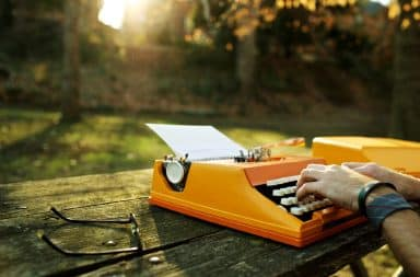 Orange typewriter outside